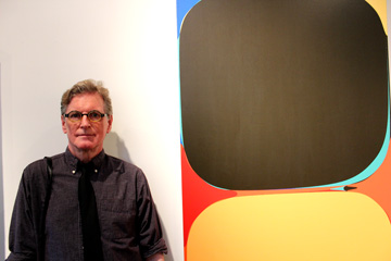 Jef Bourgeau with one of his paintings at Galerie Camille